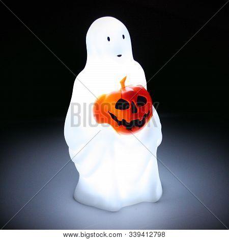 Halloween Ghost Lamp In Dark Background At Night