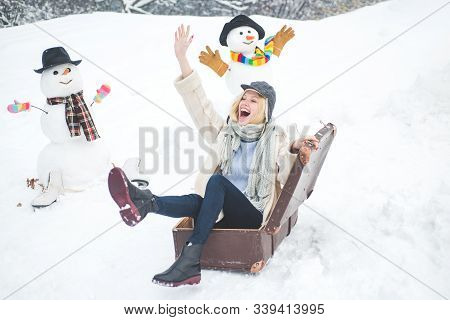 Winter Holiday Trip Concept. Planning Winter Vacations. Happy Smiling Snow Man And Winter Girl On Su