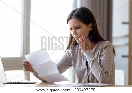 Disappointed Woman Read Bad News In Received Letter