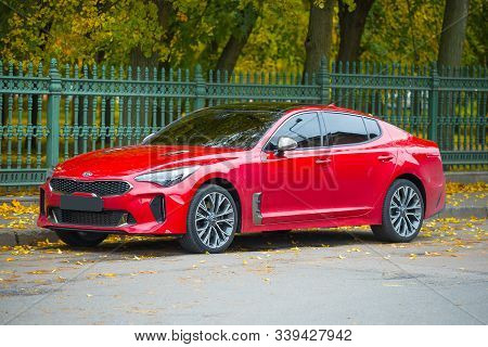 Kronstadt, Russia - October 06, 2019: Red Kia Stinger Car At Petrovsky Park On October Day