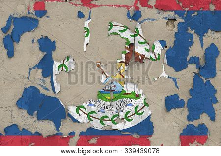 Belize flag depicted in paint colors on old obsolete messy concrete wall closeup. Textured banner on rough background poster