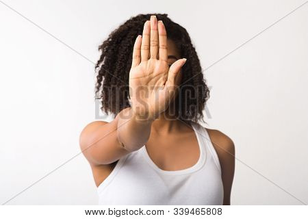 Rejection Concept. Unrecognizable African American Woman Showing Stop Gesture Isolated Over White Ba