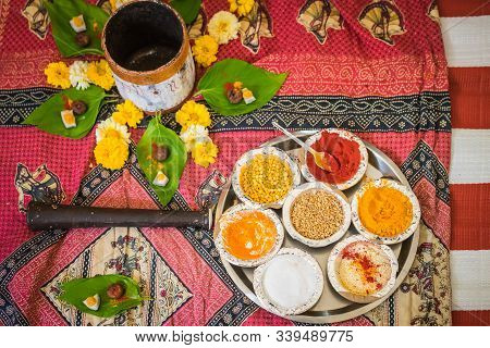 Tika, Rice, And Flowers Laid Flat And Ready For A Traditional Ceremony In A Hindu Maharashtran India