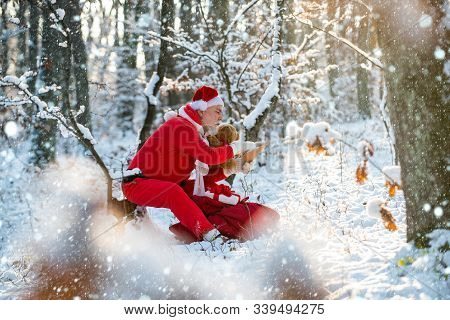 Christmas Santa Reading Letter Near The Christmas Nature Background. Funny Santa In Santa Hat Read L