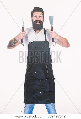 He Is A Great Cook. Happy Grill Cook With Cooking Utensils. Bearded Man Holding Fork And Spatula For