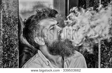 Smoking Electronic Cigarette. Stress Relief Concept. Smoking Device. Man Long Beard Relaxed With Smo