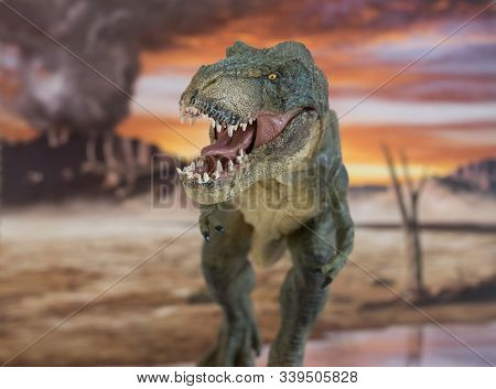 Portrait Of Walking And Dangerous Tyrannosaurus Rex With Erupting Volcano In The Background. Front V