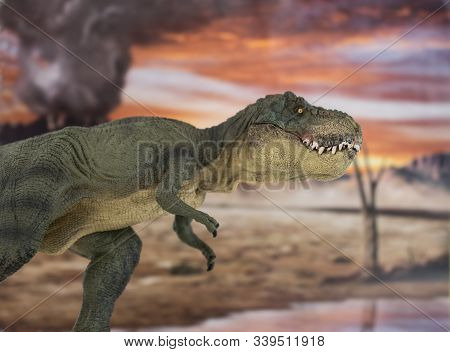 Portrait Of Walking And Dangerous Tyrannosaurus Rex With Erupting Volcano In The Background.
