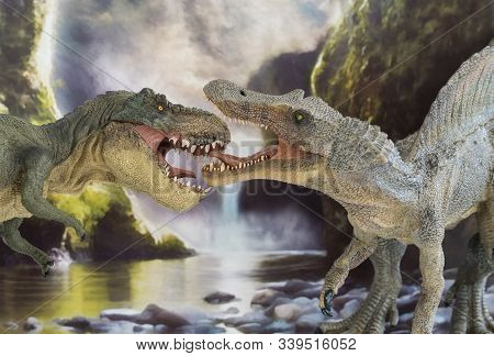 Tyrannosaurus Rex Fighting Versus A Spinosaur With Waterfall In The Background Into Prehistoric Era