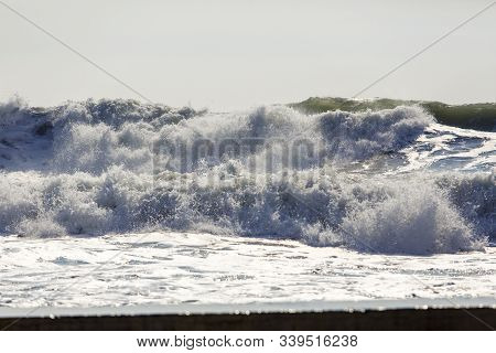 Storm Waves In The Black Sea. The Waves Are In Several Rows, Sea Foam, Whitecaps, Wind. Background.