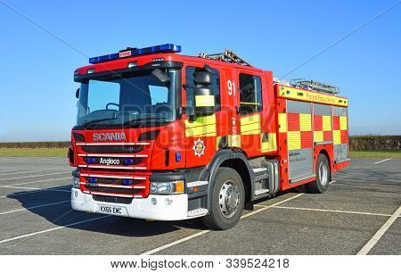 Grafham, Cambridgeshire, England - February 15, 2019: Scania Modern Fire Englne Parked On Tarmac