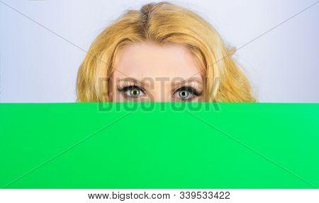 Advertising Banner. Woman Hiding Behind Billboard.blonde Girl Peeking From Behind Blank Sign. Smilin