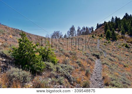 poster of Butterfield canyon hiking path views of the Oquirrh range along the Wasatch Front Rocky Mountains, by Kennecott Rio Tinto Copper mine, Tooele and Salt Lake City fall. Utah, United States.