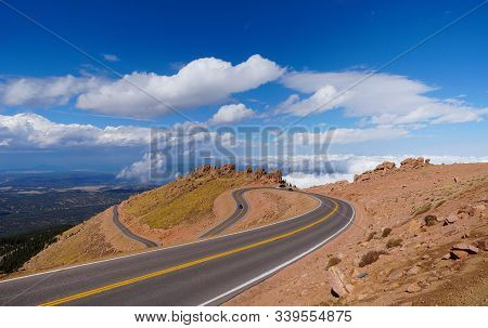 Looking Down On The Road That Takes Visitors To And From The Summit Of Pikes Peak.