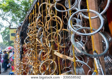 Holy Metal Bangles Are Hanging For Sale At Kalighat, Kolkata , West Bengal, India. In Hinduism, A Me