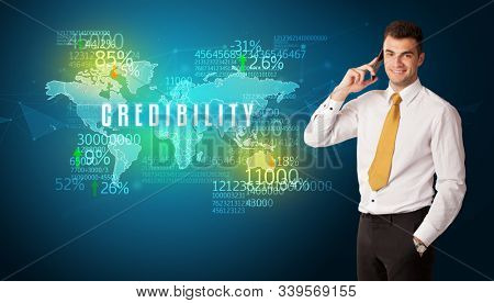 Businessman in front of a decision with CREDIBILITY inscription, business concept poster