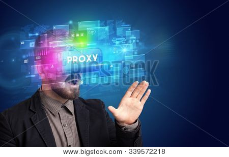 Businessman looking through Virtual Reality glasses with PROXY inscription, innovative security concept