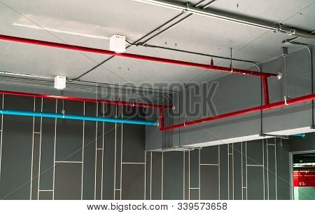 Automatic Fire Sprinkler Safety System And Red Water Supply Pipe. Fire Suppression. Fire Protection