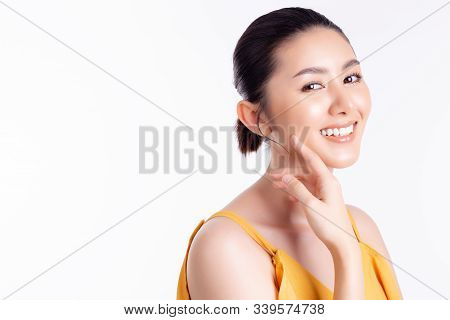 Asian Woman Apply Natural Makeup On Her Beautiful Face. Attractive Beautiful Young Lady Has Perfect