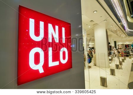 SINGAPORE - APRIL 03, 2019: close up shot of Uniqlo sign seen at a shopping mall in Singapore. Uniqlo is a Japanese casual wear designer, manufacturer and retailer.