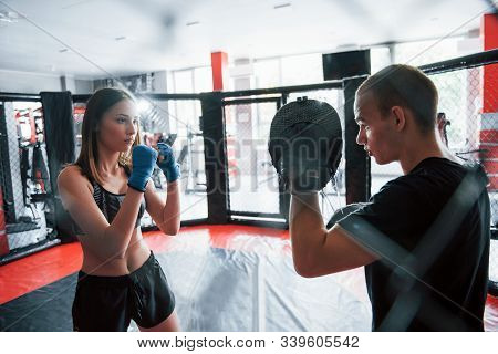 Athletic Young People Have Sparring On The Boxing Ring.