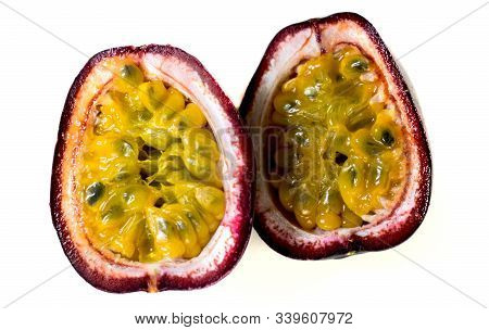 Passion Fruit ( Passiflora Edulis). The Fruit Is Cut In Two Halves. Isolated On A White Background