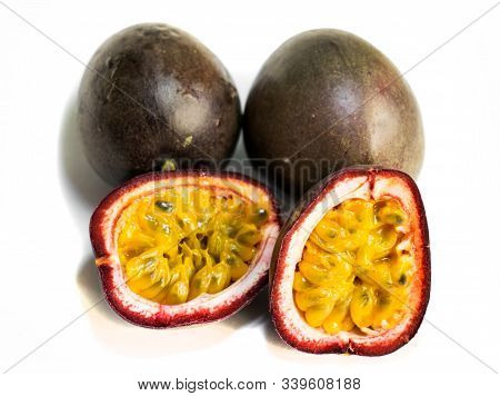 Passion Fruit ( Passiflora Edulis).3 Fruits. The Fruit Is Cut In Two Halves. Isolated On A White Bac