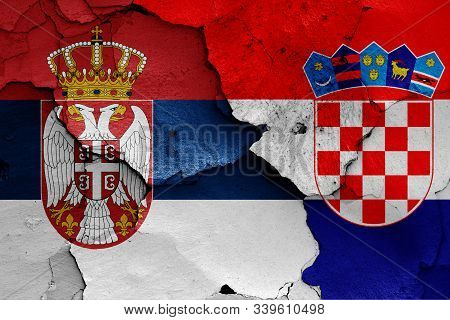 Flags Of Serbia And Croatia Painted On Cracked Wall