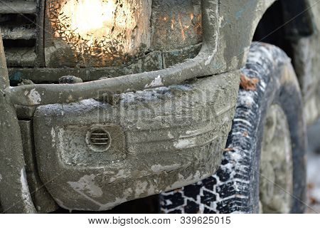 Detail Of A Dirty Wheel, A Lit Light And A Mudguard Off-road Car In Forest