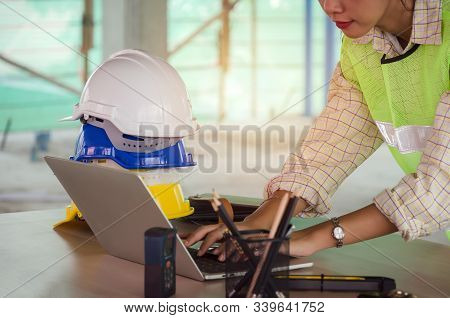 Professional Architect, Engineer Or Interior Hands Working With Laptop And Safety Helmet On Workplac