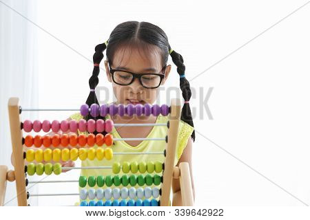Brain Development At Early Childhood With The Abacus. Kindergarten Children Grabbing Colorful Wooden