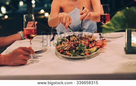 Young Woman With A Dinner On Beach