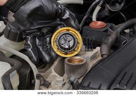 Oil Fill Cap Unscrewed. Oil Change. Car Repair Shop.