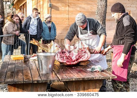 Butchers Slaughtering A Pig