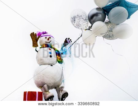 Happy Winter Time. Snowman In Hat, Scarf, Gloves With Air Balloons And Gift. Hello Winter. Greeting