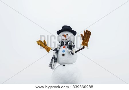 Christmas And Winter Fashion. Happy Snowman Waving In Hand. Happy Holiday Celebration. Christmas Sno