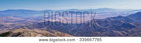 Wasatch Front Rocky Mountain Landscapes From Oquirrh Range Looking At Utah Lake During Fall. Panoram
