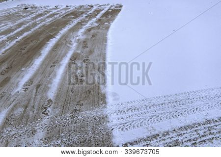 Snow Fell On The Road, Cleaning Snow. Traces Of Cars On White Snow. The Paths Cleared By A Shovel Of
