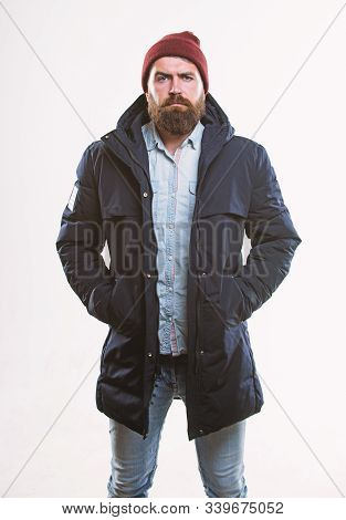 Man Bearded Hipster Posing Confidently In Warm Black Jacket Or Parka. Hipster Modern Fashion. Guy We