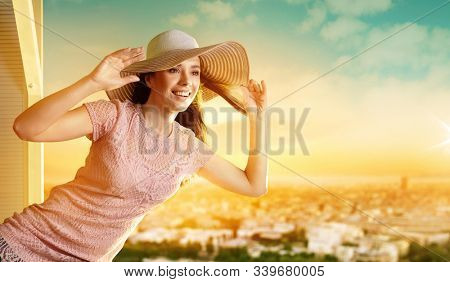 Young smiling woman wearing a hat