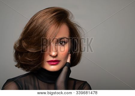 Brunette Girl With Shiny Hair. Beautiful Woman With Bob Haircut