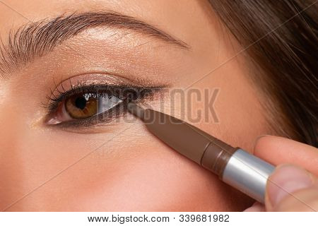 Beautiful Eye Of Woman With Amazing Make Up. Girl Is Applying Eyeliner On Eyes