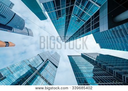 Skyscrapers in downtown area, bottom view, blue tones