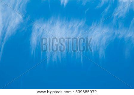 High White Clouds In Bright Blue Sky