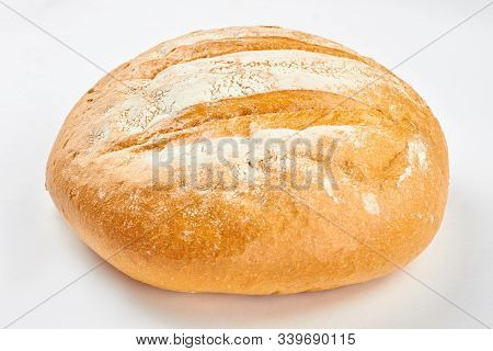Loaf Of Fresh Bread On White Background. Delicious Wheat Bread. Easy Artisan Bread Recipe.