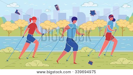 Young Man And Two Women Enjoying Nordic Walking In Open Air. Health Promoting Physical Activity With