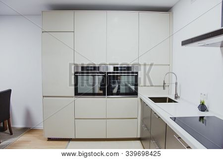 Minimalistic Kitchen Interior, Sink, Oven, Stove, Range Hood Close Up 1
