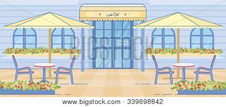 Romantic European Cafe Entrance Door. Empty Table And Chairs Under Patio Umbrella. Flower Decoration