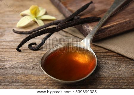 Aromatic Homemade Vanilla Extract On Wooden Table, Closeup