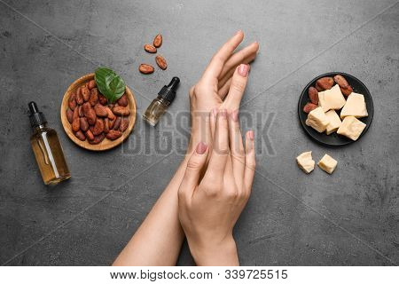 Woman Applying Organic Cocoa Butter At Table, Top View